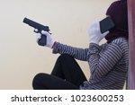 gunman carrying a gun. there is ... | Shutterstock . vector #1023600253