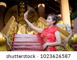 chinese woman wearing... | Shutterstock . vector #1023626587