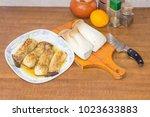 baked halves of the eringi... | Shutterstock . vector #1023633883