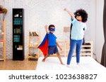 african american happy and... | Shutterstock . vector #1023638827