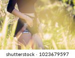 closeup of young fit woman... | Shutterstock . vector #1023679597
