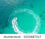 people are playing a jet ski in ... | Shutterstock . vector #1023687217