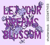 let your dreams blossom  hand... | Shutterstock .eps vector #1023697453