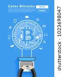mining bitcoin from businessman ...   Shutterstock .eps vector #1023698047