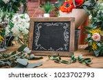 blank charcoal board among...   Shutterstock . vector #1023702793