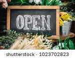 open sign on wooden table among ...   Shutterstock . vector #1023702823