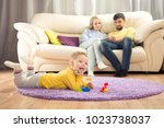 parents sit on the couch.... | Shutterstock . vector #1023738037