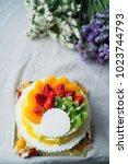 wedding cake with fresh fruits  ... | Shutterstock . vector #1023744793