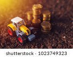 agricultural tractor toy and... | Shutterstock . vector #1023749323