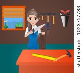 female carpenter holding saw  | Shutterstock .eps vector #1023757783
