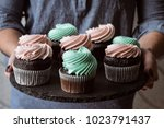 tasty cupcakes on background...   Shutterstock . vector #1023791437