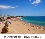 beach in albufeira  algarve ... | Shutterstock . vector #1023793633