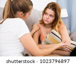 sad girl is talking with... | Shutterstock . vector #1023796897