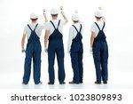 rear view.team of construction... | Shutterstock . vector #1023809893