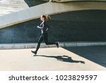 woman jogging or running  side... | Shutterstock . vector #1023829597