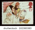 Small photo of UNITED KINGDOM - CIRCA 1984: A stamp printed in United Kingdom shows a Christmas postage stamp with Mary, Joseph and Baby Jesus, circa 1984