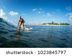 lady surfer rides perfect ocean ... | Shutterstock . vector #1023845797