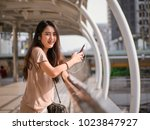 happy smiling young asian woman ... | Shutterstock . vector #1023847927