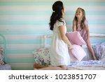family reading bedtime. pretty...   Shutterstock . vector #1023851707