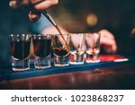 bartender pouring and serving... | Shutterstock . vector #1023868237