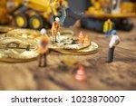 miniature figure people working ...   Shutterstock . vector #1023870007