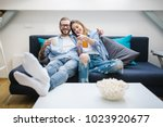 young couple sitting on the... | Shutterstock . vector #1023920677