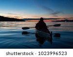 man kayaking on a sea kayak... | Shutterstock . vector #1023996523