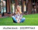 ukrainian young woman blonde... | Shutterstock . vector #1023997663