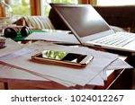 laptop computer and cellphone... | Shutterstock . vector #1024012267