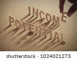 potential income wood word on... | Shutterstock . vector #1024021273