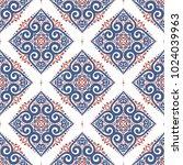 blue and orange ornamental... | Shutterstock .eps vector #1024039963