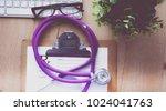 a medical stethoscope near a...   Shutterstock . vector #1024041763