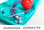 a stethoscope shaping a heart... | Shutterstock . vector #1024041793
