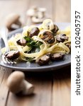 vegetarian dish with tagliatelles, spinach and mushrooms - stock photo