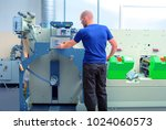 worker next to the printing... | Shutterstock . vector #1024060573