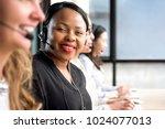 friendly black woman wearing... | Shutterstock . vector #1024077013