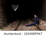 sexy man on the train tracks ... | Shutterstock . vector #1024089967