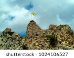 Small photo of Arnoun, Nabatieh Governorate, Lebanon - 5.1.05 Flag showing Hezbollah control of Beaufort Crusader castle (Qala'at al-Shaqif).