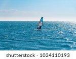 windsurfing on the sea  backlit ...   Shutterstock . vector #1024110193