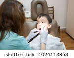 dentist is treating a boy's... | Shutterstock . vector #1024113853