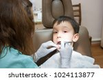 dentist is treating a boy's... | Shutterstock . vector #1024113877
