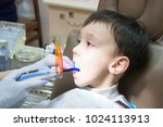 dentist is treating a boy's... | Shutterstock . vector #1024113913