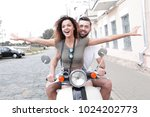 beautiful young couple is... | Shutterstock . vector #1024202773