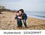 young woman playing at sea sand ... | Shutterstock . vector #1024209997