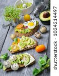 Small photo of bruschetta with avocado microgrin, quail eggs and Adyghe cheese and mozzarella