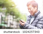 old man use phone and play ar... | Shutterstock . vector #1024257343