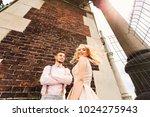 boyfriend leaned to brick wall... | Shutterstock . vector #1024275943