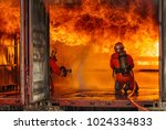 firefighters fighting a fire... | Shutterstock . vector #1024334833
