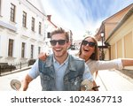 happy young couple riding... | Shutterstock . vector #1024367713