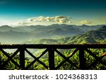 wooden terrace and mountain view | Shutterstock . vector #1024368313